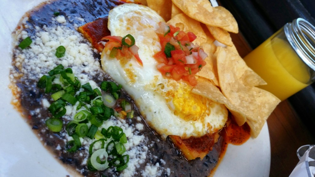 """The Cowboy"" two eggs (Any Style) over grilled polenta, drenched in tomato chili sauce $11"